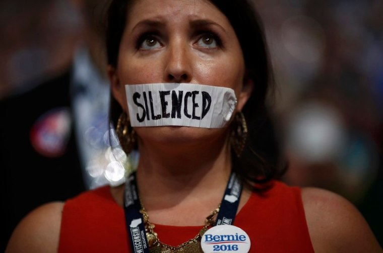 A supporter of former Democratic U.S. presidential candidate Bernie Sanders wears tape across her mouth in protest on the floor at the Democratic National Convention in Philadelphia