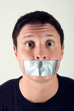 A man with duct tape over his mouth.Similar Images: